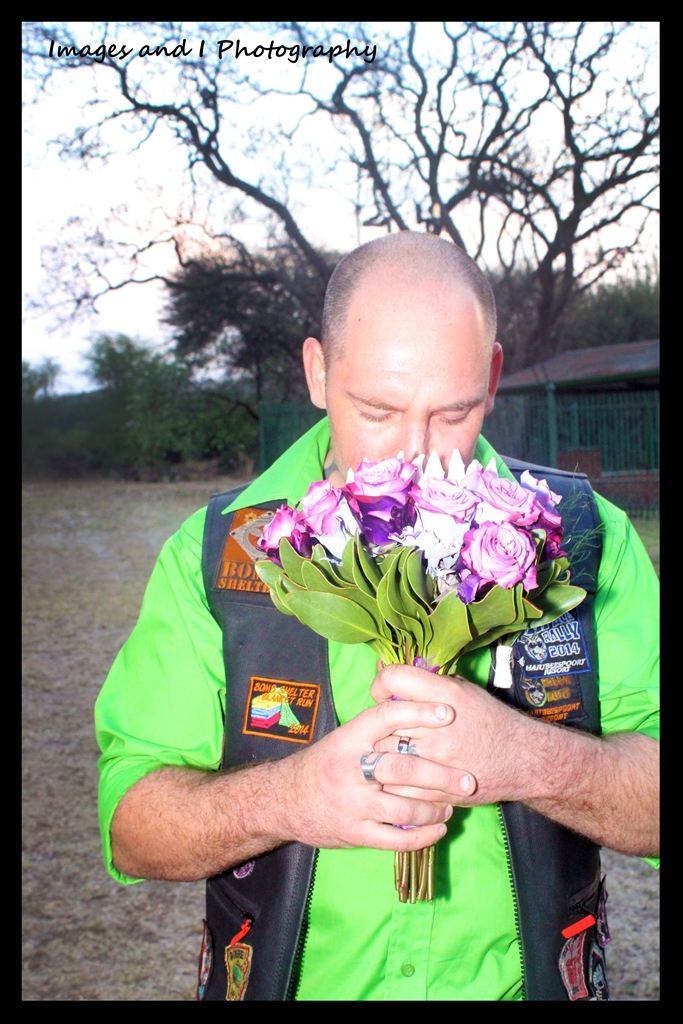 Groom smelling Flowers Wedding Photoshoot | Photoshoots Pretoria
